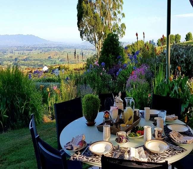 https://kamahi.co.nz/wp-content/uploads/Al-fresco-breakfast-in-the-garden-.jpg