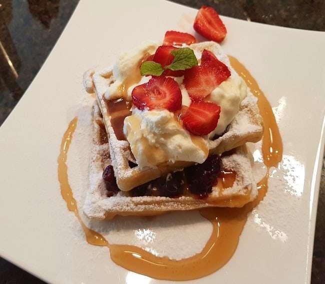 https://kamahi.co.nz/wp-content/uploads/Breakfast-waffles-strawberriescream-mapple-syrup.jpg