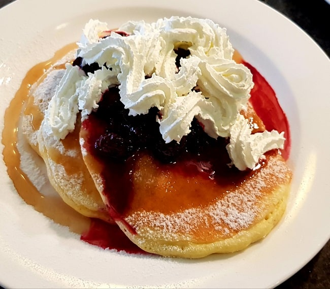 Lemon Pancakes with Berry Sauce and Whipped Cream
