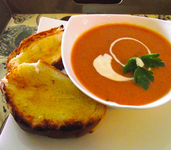 Tomato soup with fresh cream and toasted buttered ciabatta